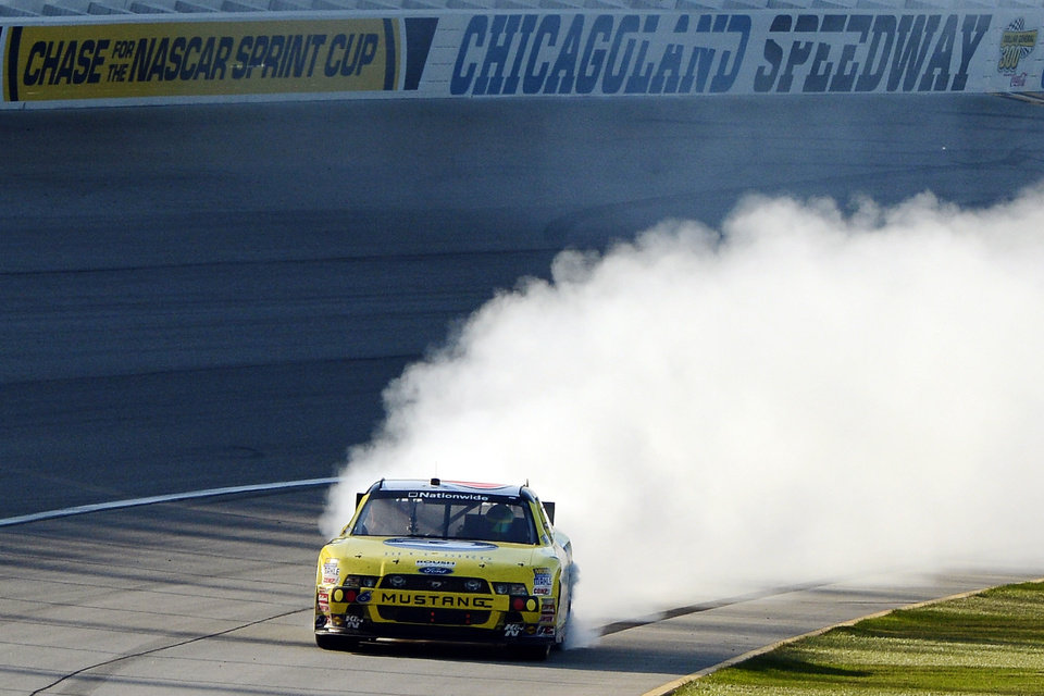 Photo -   Ricky Stenhouse Jr., performs a burnout to celebrate his NASCAR Nationwide Series auto race win at Chicagoland Speedway in Joliet, Ill., Saturday, Sept. 15, 2012. (AP Photo/Warren Wimmer)