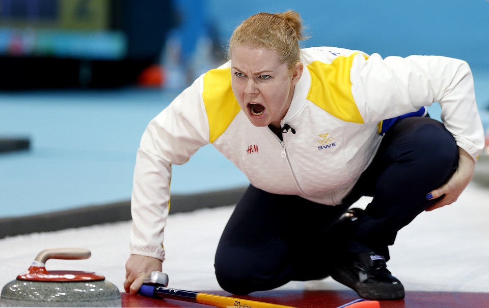 Photo - Sweden's Margaretha Sigfridsson shouts instructions to her teammates during the women's curling competition against the United States at the 2014 Winter Olympics, Saturday, Feb. 15, 2014, in Sochi, Russia. (AP Photo/Wong Maye-E)
