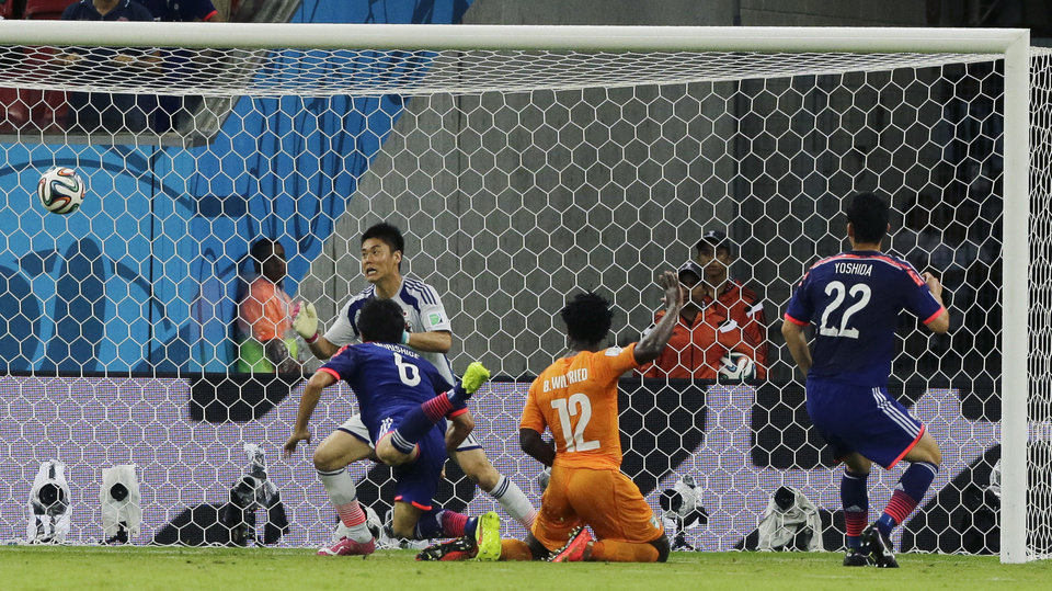 Photo - Ivory Coast's Wilfried Bony, (12), scores his side's first goal during the group C World Cup soccer match between Ivory Coast and Japan at the Arena Pernambuco in Recife, Brazil, Saturday, June 14, 2014.   (AP Photo/Shuji Kajiyama)