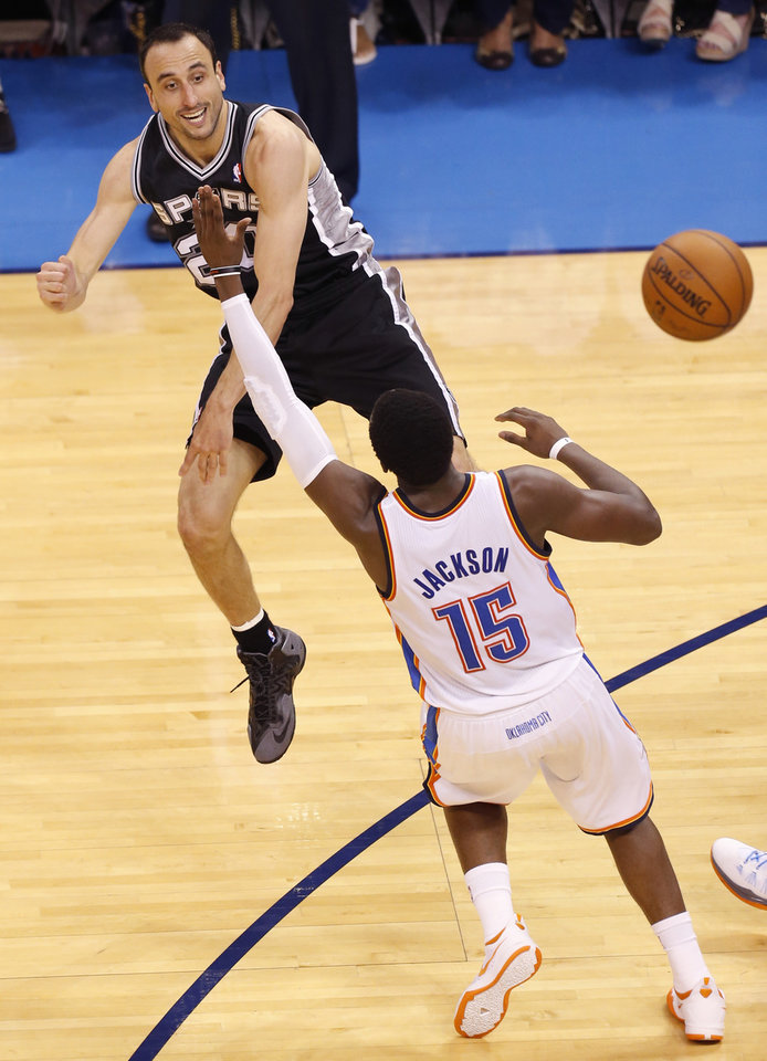 Photo - San Antonio's Manu Ginobili (20) passes around Oklahoma City's Reggie Jackson (15) during Game 6 of the Western Conference Finals in the NBA playoffs between the Oklahoma City Thunder and the San Antonio Spurs at Chesapeake Energy Arena in Oklahoma City, Saturday, May 31, 2014. Photo by Nate Billings, The Oklahoman