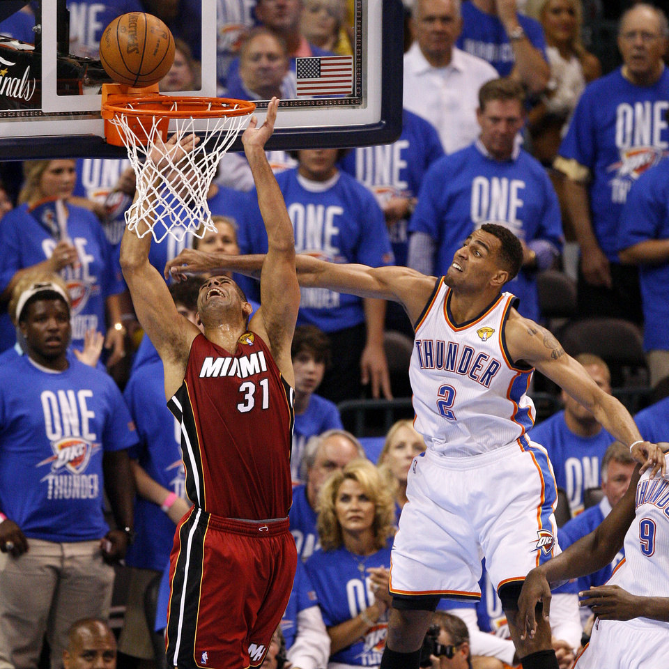 Oklahoma City's Thabo Sefolosha (2) defends Miami's Shane Battier (31) during Game 1 of the NBA Finals between the Oklahoma City Thunder and the Miami Heat at Chesapeake Energy Arena in Oklahoma City, Tuesday, June 12, 2012. Photo by Nate Billings, The Oklahoman