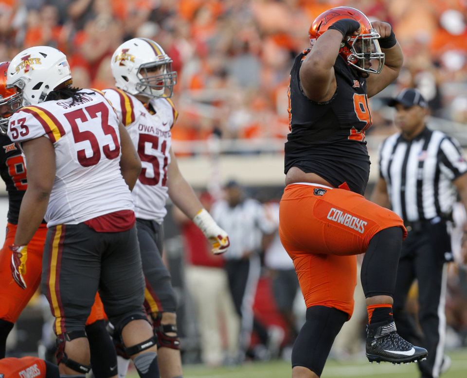 Photo - Oklahoma State's Motekiai Maile (90) celebrates a sack on Iowa State's Joel Lanning (7) in the fourth quarter during a college football game between the Oklahoma State University Cowboys (OSU) and the Iowa State University at Boone Pickens Stadium in Stillwater, Okla., Saturday, Oct. 8, 2016. Photo by Sarah Phipps, The Oklahoman