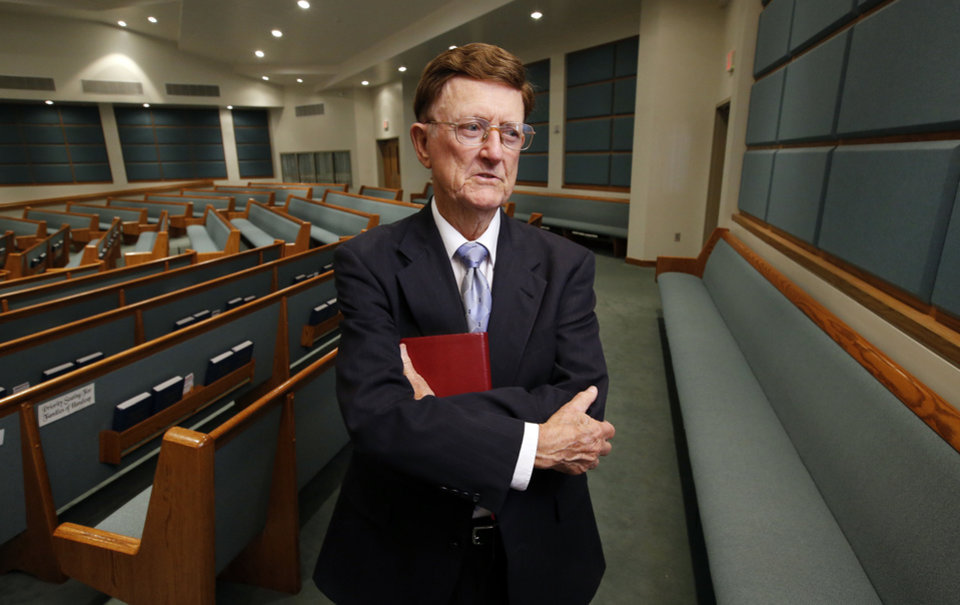 Photo - Lewis Hale poses for a picture in the sanctuary of Southwest Church of Christ where he has served as pulpit minister for 57 years. Hale retired July 7 and a reception is planned for him at the church on Saturday, July 13.   STEVE SISNEY - THE OKLAHOMAN