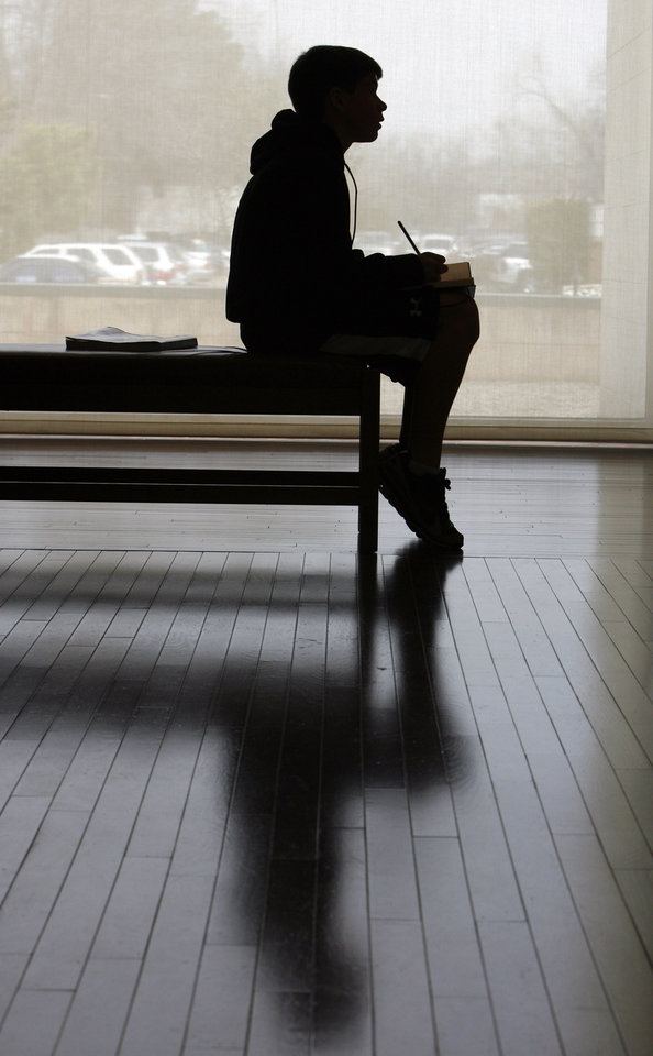 Dakota Cain writes as he is inspired while looking at art as writer Nathan Brown works with aspiring writers from Irving Middle School at the Fred Jones Jr. Museum of Art at the University of Oklahoma (OU) in Norman, Oklahoma, on Wednesday, March 4, 2009. Photo by Steve Sisney, The Oklahoman
