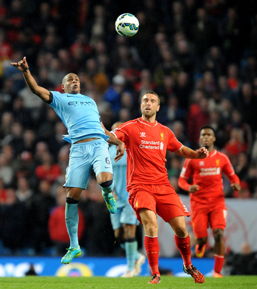 Photo - Manchester City's  Fernando, left, contests the ball with Liverpool's Rickie Lambert during the English Premier League soccer match between Manchester City and Liverpool at the Etihad Stadium, in Manchester, England, Monday, Aug. 25, 2014. (AP Photo/Rui Vieira)
