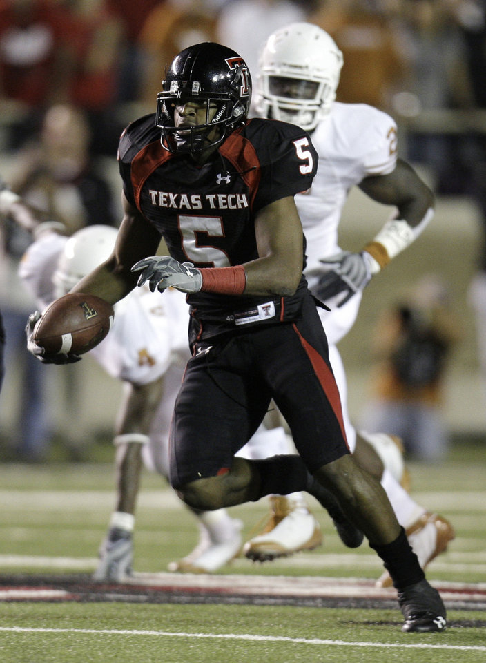 Photo - ** FILE ** In this Nov. 1, 2008 file photo, Texas Tech University wide receiver Michael Crabtree gets extra yardage after a catch during the NCAA college football game against Texas in  Lubbock, Texas. The 6-foot-3 Crabtree, who is averaging 102.3 yards receiving, has been hurting defenses the past two seasons with his quick-strike catches and his ability to make moves after he gets the ball.  (AP Photo/LM Otero, File)  ORG XMIT: NY171
