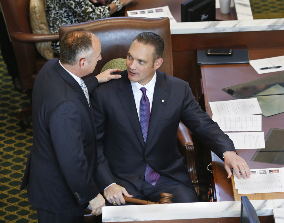 Photo - Outgoing Speaker Jeff Hickman, left, from Fairview, talks to current Speaker Charles McCall, Atoka, at House of Representatives' swearing-in ceremony in theOklahoma House Chamber on Wednesday, Nov. 16, 2016. McCall hasn't said publicly where he stands on further reducing the income tax. Photo by Jim Beckel, The Oklahoman