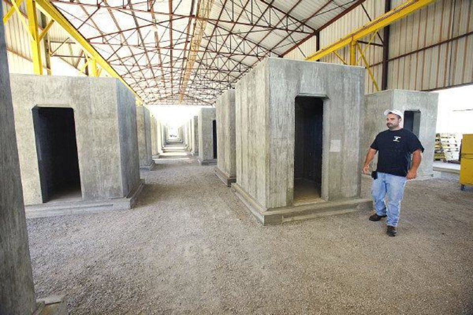Photo - Andrew Zagorski Jr., vice president of Oz Saferooms, shows safe rooms manufactured at the factory, 3216 SE 30 in Del City.  PAUL B. SOUTHERLAND - The Oklahoman