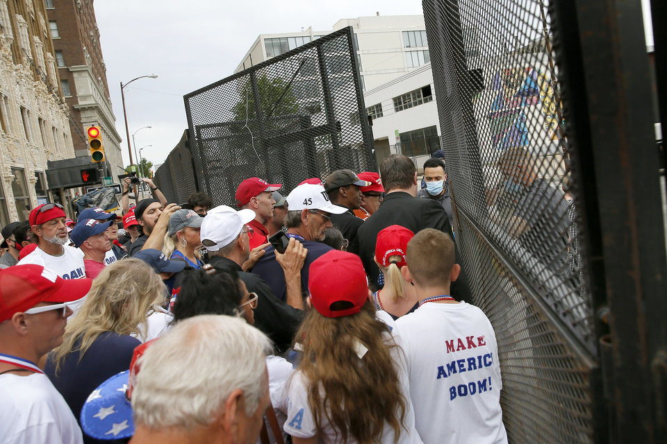 Photo - The first group of President Donald Trump supporters are let through a security gate  before a rally at the BOK Center in Tulsa, Okla., Saturday, June 20, 2020. [Bryan Terry/The Oklahoman]
