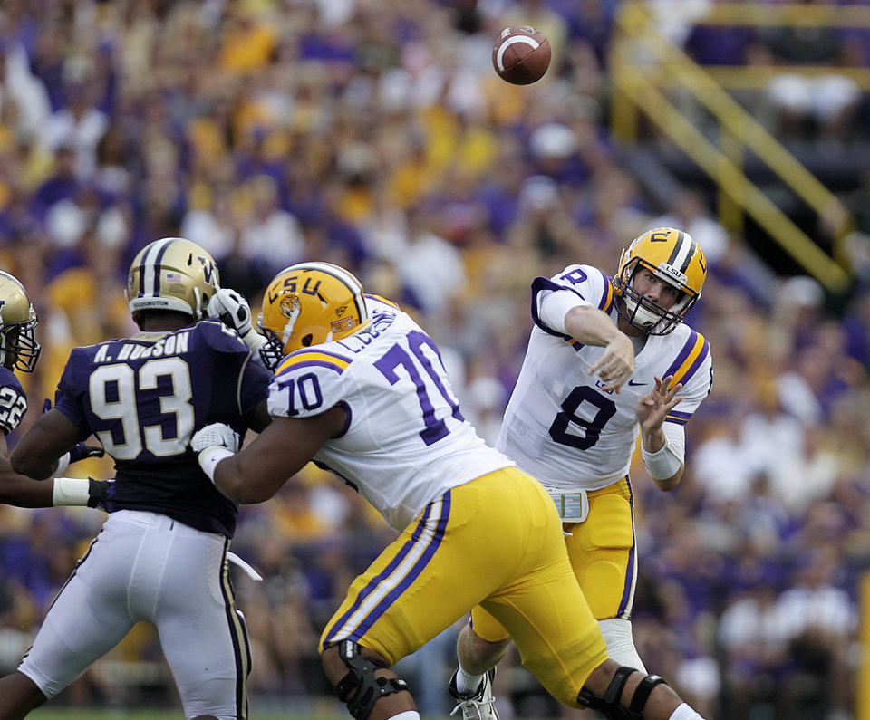 Photo -   LSU quarterback Zach Mettenberger (8) passes during the first half of an NCAA college football game against Washington in Baton Rouge, La., Saturday, Sept. 8, 2012. LSU won 41-3. (AP Photo/Gerald Herbert)