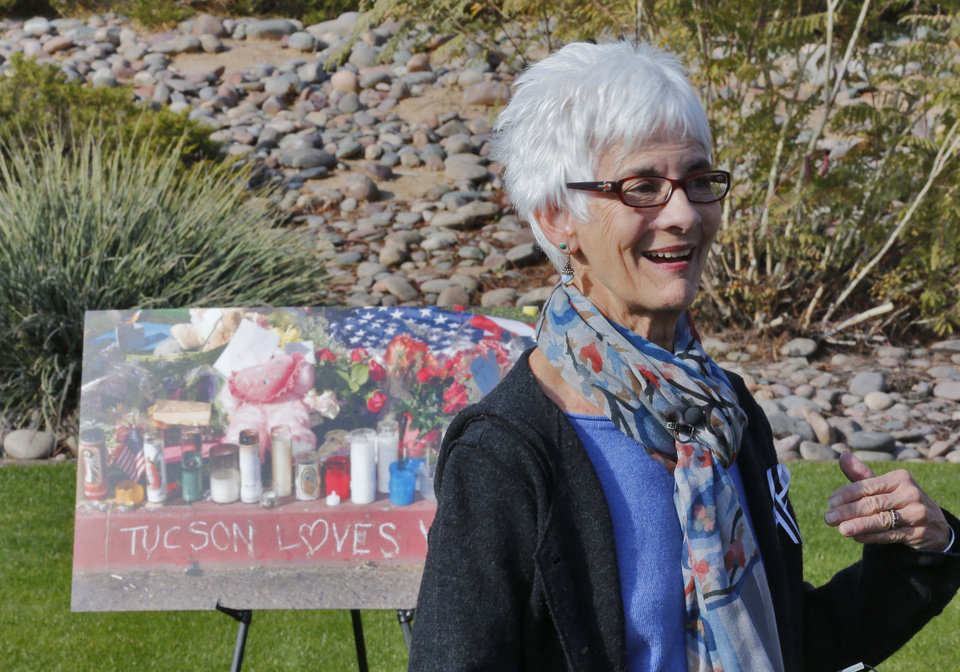 Photo - Nancy Barber, wife of Tucson shooting survivor and U.S. Rep. Ron Barber, D-Ariz., speaks after a remembrance ceremony on the third anniversary of the Tucson shootings, Wednesday, Jan. 8, 2014, in Tucson, Ariz. Six people were killed and 13 wounded, including U.S. Rep. Gabrielle Giffords, D-Ariz., in the shooting rampage at a community event hosted by Giffords in 2011.  Jared Lee Loughner was sentenced in November 2012 to seven consecutive life sentences, plus 140 years, after he pleaded guilty to 19 federal charges in the shooting. (AP Photo/Matt York)