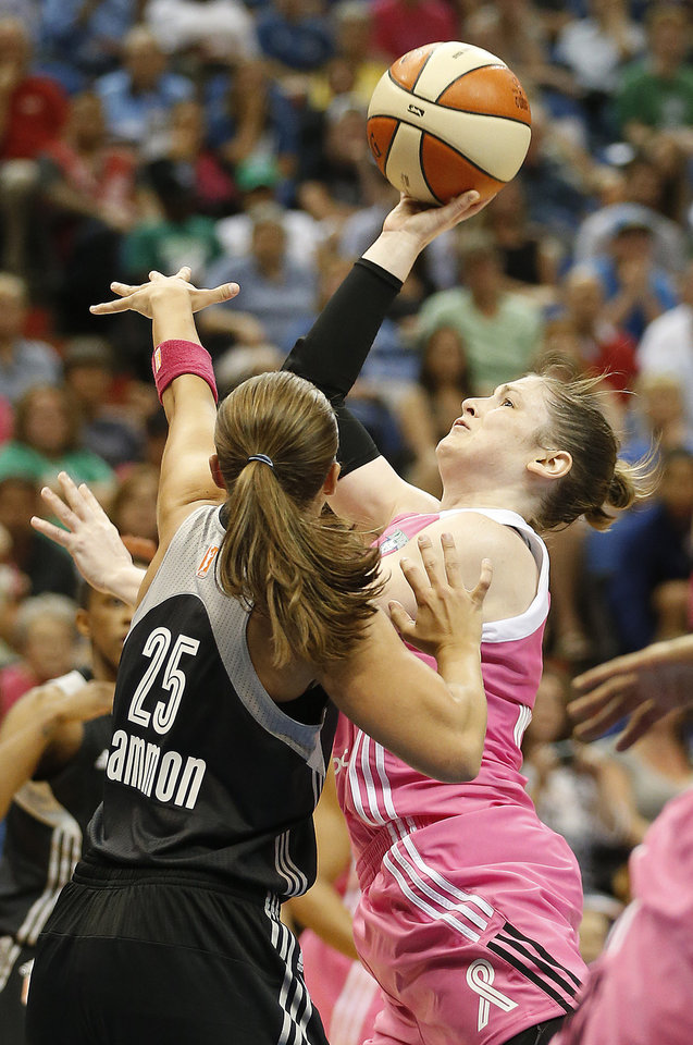 Photo - Minnesota Lynx guard Lindsay Whalen looks to shoot against San Antonio Stars guard Becky Hammon (25) during the first half of a WNBA basketball game, Friday, July 25, 2014, in Minneapolis. (AP Photo/Stacy Bengs)
