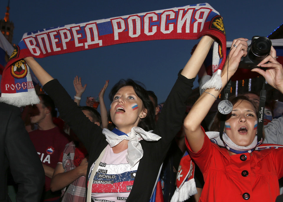 "<p>In this photo taken late Saturday, June 16, 2012, soccer fans crowd a street to watch the Euro 2012 soccer championship Group A match between Greece and Russia in Kiev, Ukraine. The sign reading ""Forward, Russia!"" (AP Photo/Sergei Grits)</p>"