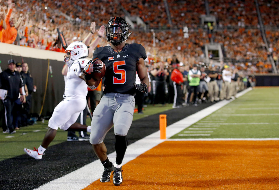 Photo - Oklahoma State's Justice Hill (5) scores a touchdown in front of South Alabama's Bull Barge (8) in the second quarter during a college football game between Oklahoma State (OSU) and South Alabama at Boone Pickens Stadium in Stillwater, Okla., Saturday, Sept. 8, 2018. Photo by Sarah Phipps, The Oklahoman