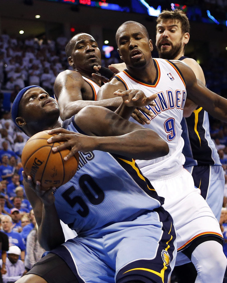 Photo - Memphis' Zach Randolph (50) looks to get the ball past Oklahoma City's Serge Ibaka (9) and Kendrick Perkins (5) near Memphis' Marc Gasol (33) during Game 2 in the first round of the NBA playoffs between the Oklahoma City Thunder and the Memphis Grizzlies at Chesapeake Energy Arena in Oklahoma City, Monday, April 21, 2014. Memphis won 111-105 in overtime. Photo by Nate Billings, The Oklahoman