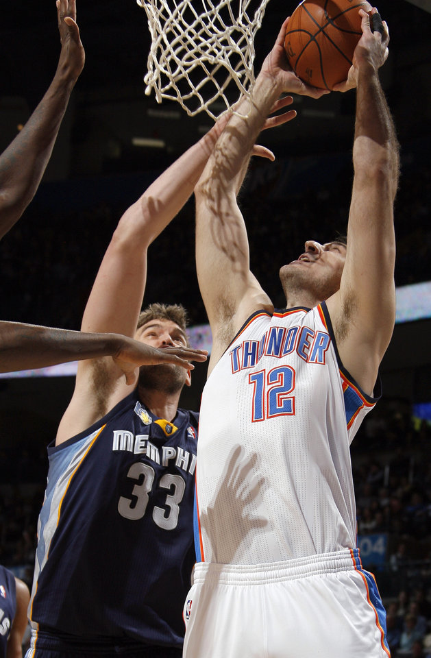 Oklahoma City's Nenad Krstic (12) shoots over Memphis' Marc Gasol (33) during the NBA basketball game between the Oklahoma City Thunder and the Memphis Grizzlies, Saturday, Jan. 8, 2011, at the Oklahoma City Arena. Photo by Sarah Phipps, The Oklahoman