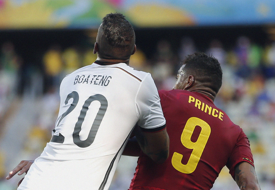 Photo - Ghana's Kevin-Prince Boateng, right, challenges Germany's Jerome Boateng during the group G World Cup soccer match the Arena Castelao in Fortaleza, Brazil, Saturday, June 21, 2014. (AP Photo/Matthias Schrader)
