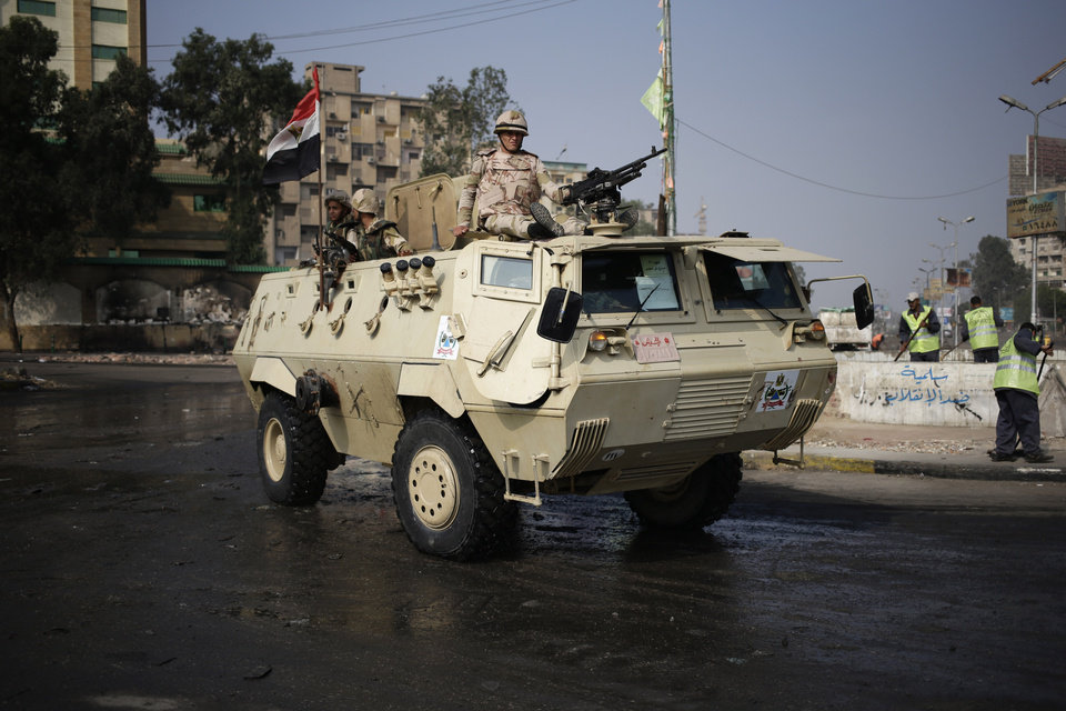 Photo - Egyptian Army soldiers stand guard outside the Rabaah al-Adawiya mosque, in the center of the largest protest camp of supporters of ousted President Mohammed Morsi, that was cleared by security forces, in the district of Nasr City, Cairo, Egypt, Friday, Aug. 16, 2013. Egypt is bracing for more violence after the Muslim Brotherhood called for nationwide marches after Friday prayers and a