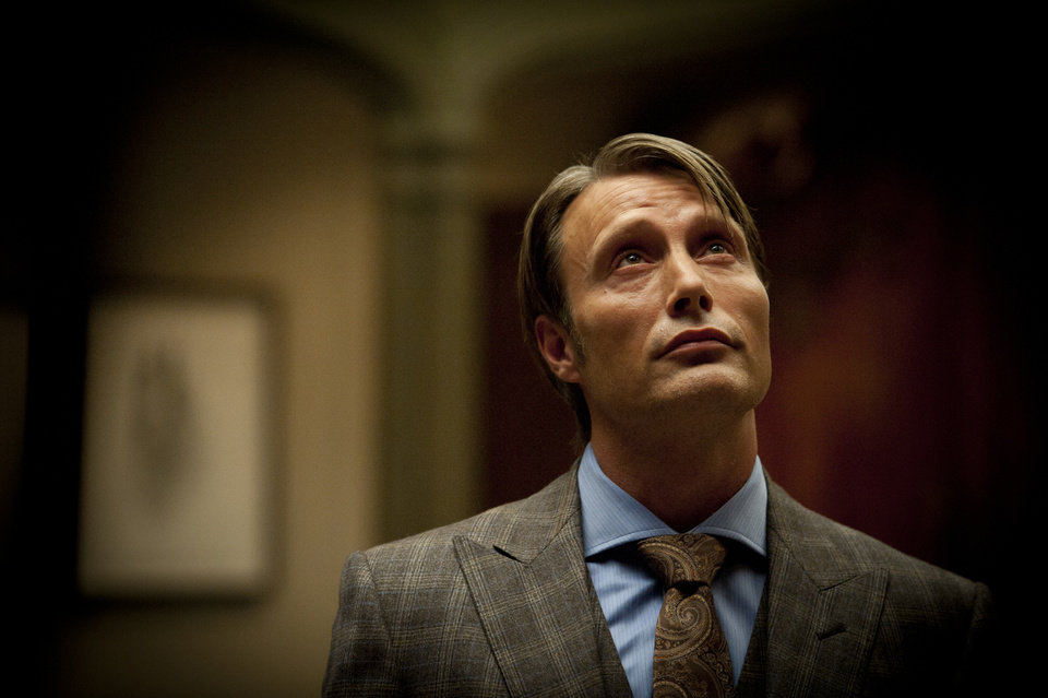 This publicity image released by NBC shows Mads Mikkelsen as Dr. Hannibal Lecter in a scene from the TV series,