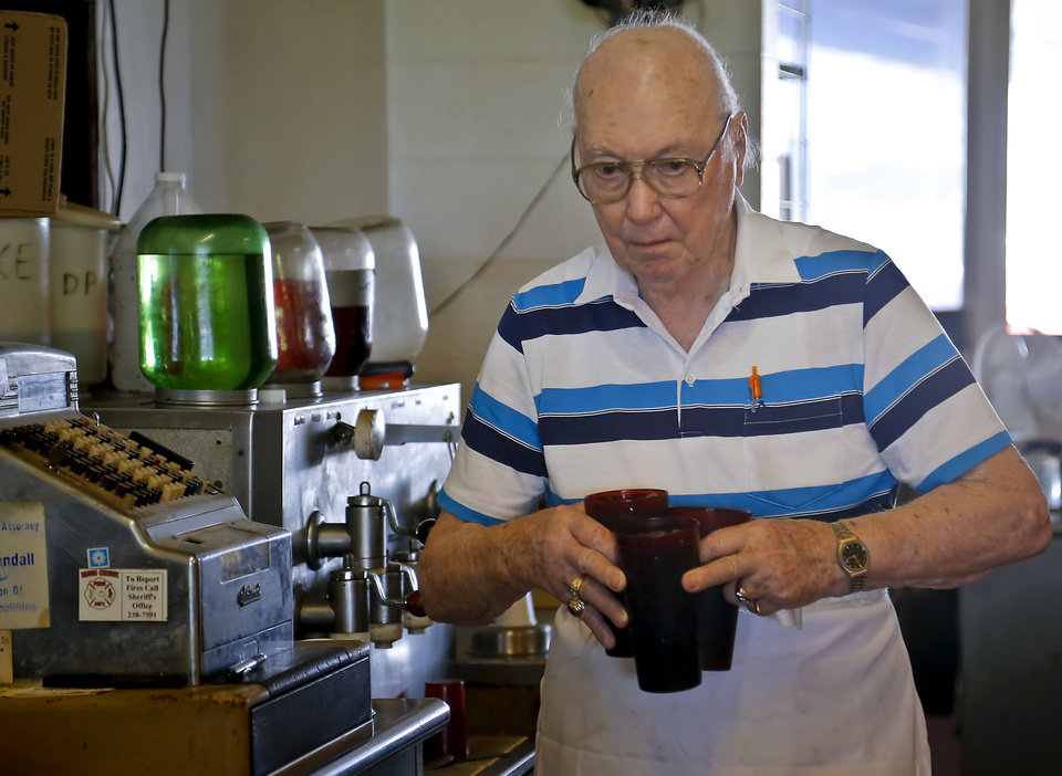Photo - Owner Johnny Ballard prepares drinks during the lunch hour at Ballard's Drive-In located in Pauls Valley, Okla. Monday, July 16, 2012.   Photo by Chris Landsberger, The Oklahoman