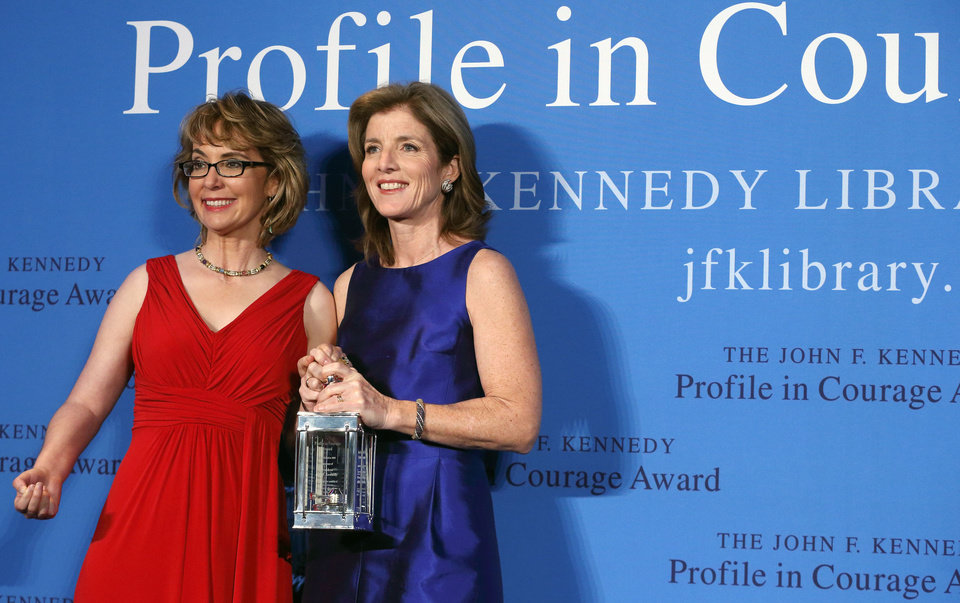 Photo - Caroline Kennedy, right, poses with former Arizona congresswoman Gabrielle Giffords after presenting her with the John F. Kennedy Profile in Courage Award at the JFK Library in Boston, Sunday, May 5, 2013.  (AP Photo/Michael Dwyer)