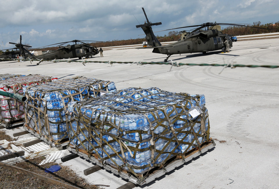 Photo - Military personnel load water and supplies into helicopters for distribution at the Florida Keys Marathon Airport, Wednesday, Sept. 13, 2017, in Marathon, Fla. (AP Photo/Wilfredo Lee)