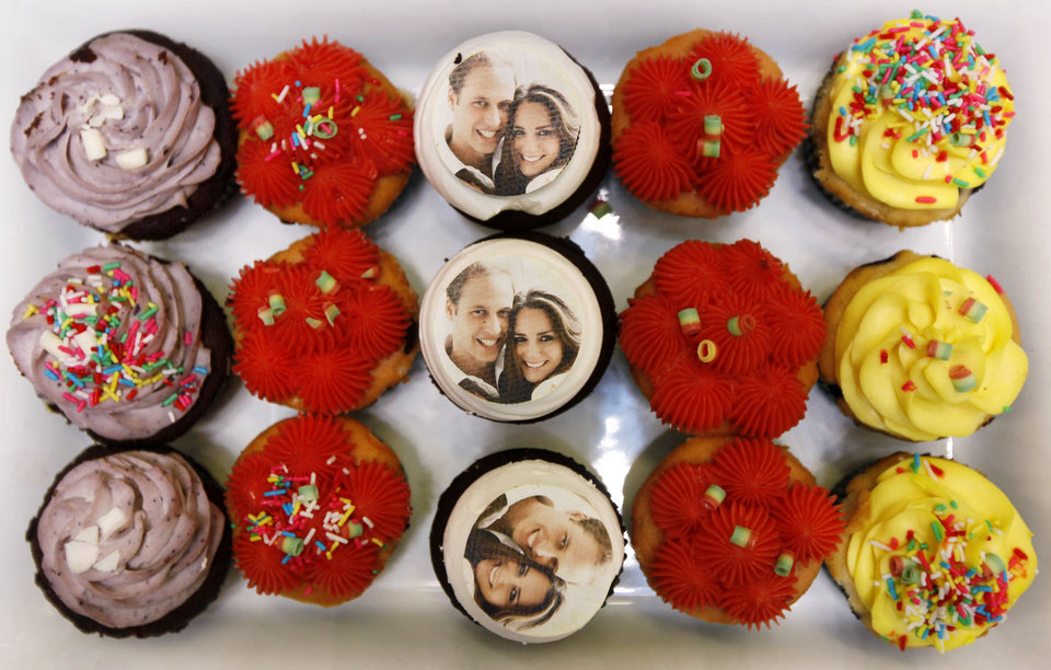 Photo - Cakes celebrating the Royal Wedding by Britain's Prince William and Kate Middleton are displayed at a shopping mall in Hong Kong Friday, April 29, 2011.  (AP Photo/Kin Cheung)