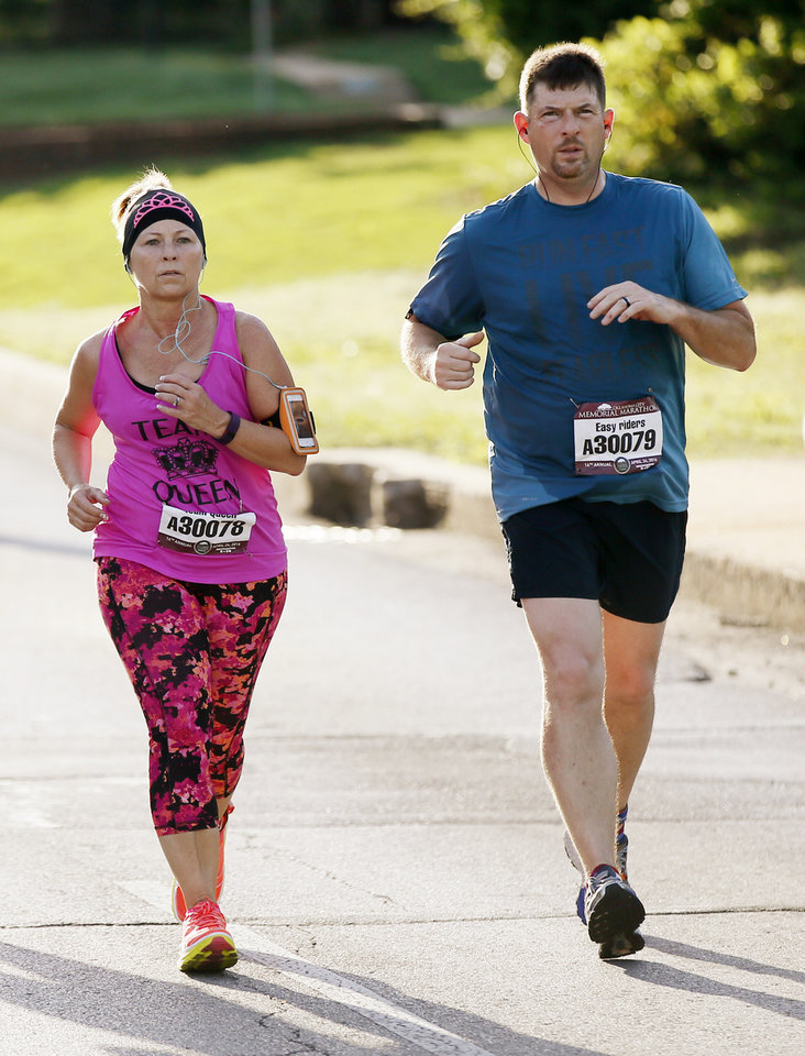 Photo - Newlyweds Teresa Simpson and Johnny Paxson run in the first leg of the relay of the Oklahoma City Memorial Marathon on Sunday. (Photo by Nate Billings, The Oklahoman)