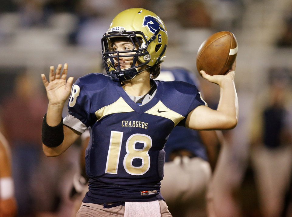 Photo - Heritage Hall's Michael McMullen throws a pass against Davis during their high school football game in Oklahoma City, Friday, Sept. 20, 2013. Photo by Bryan Terry, The Oklahoman