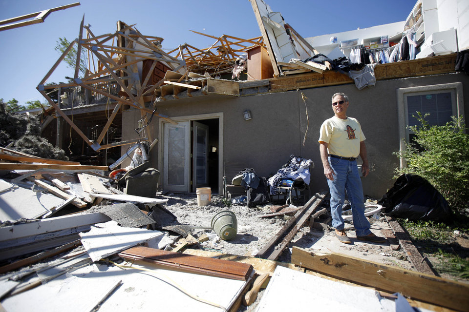 Photo - Gordon Beckett stands outside his home after a tornado moved through Woodward, Okla., Sunday, April 15, 2012. Photo by Bryan Terry
