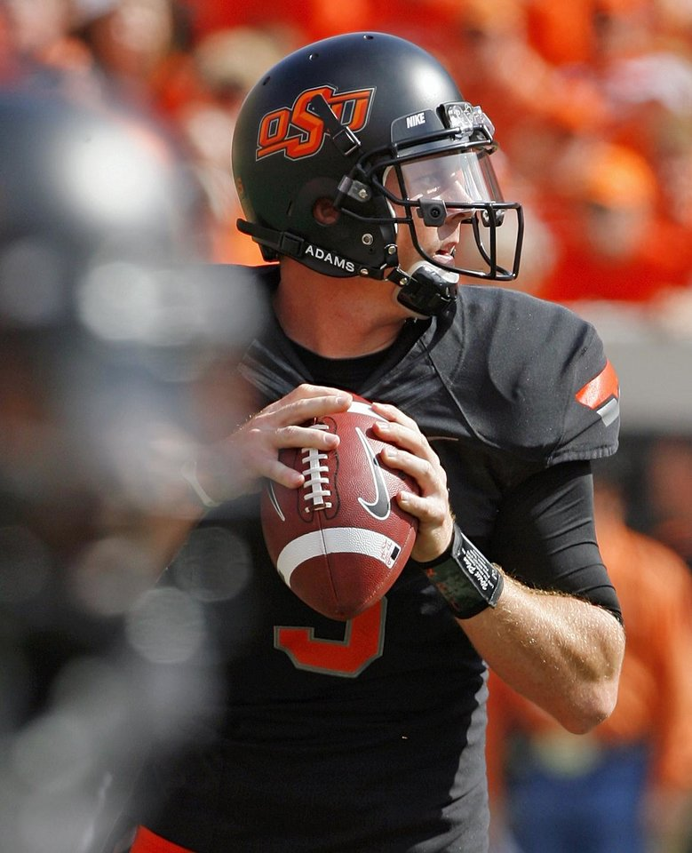 Photo - Oklahoma State's Brandon Weeden (3) throws during a college football game between the Oklahoma State University Cowboys (OSU) and the University of Kansas Jayhawks (KU) at Boone Pickens Stadium in Stillwater, Okla., Saturday, Oct. 8, 2011 Photo by Steve Sisney, The Oklahoman