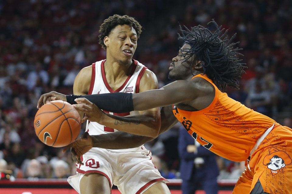 Photo - Oklahoma State's Isaac Likekele (13) knocks the ball away from Oklahoma's Alondes Williams (15) during a Bedlam college basketball game between the University Oklahoma Sooners (OU) and the Oklahoma State Cowboys (OSU) at the Lloyd Noble Center in Norman, Okla., Saturday, Feb. 1, 2020. Oklahoma won 82-69. [Bryan Terry/The Oklahoman]