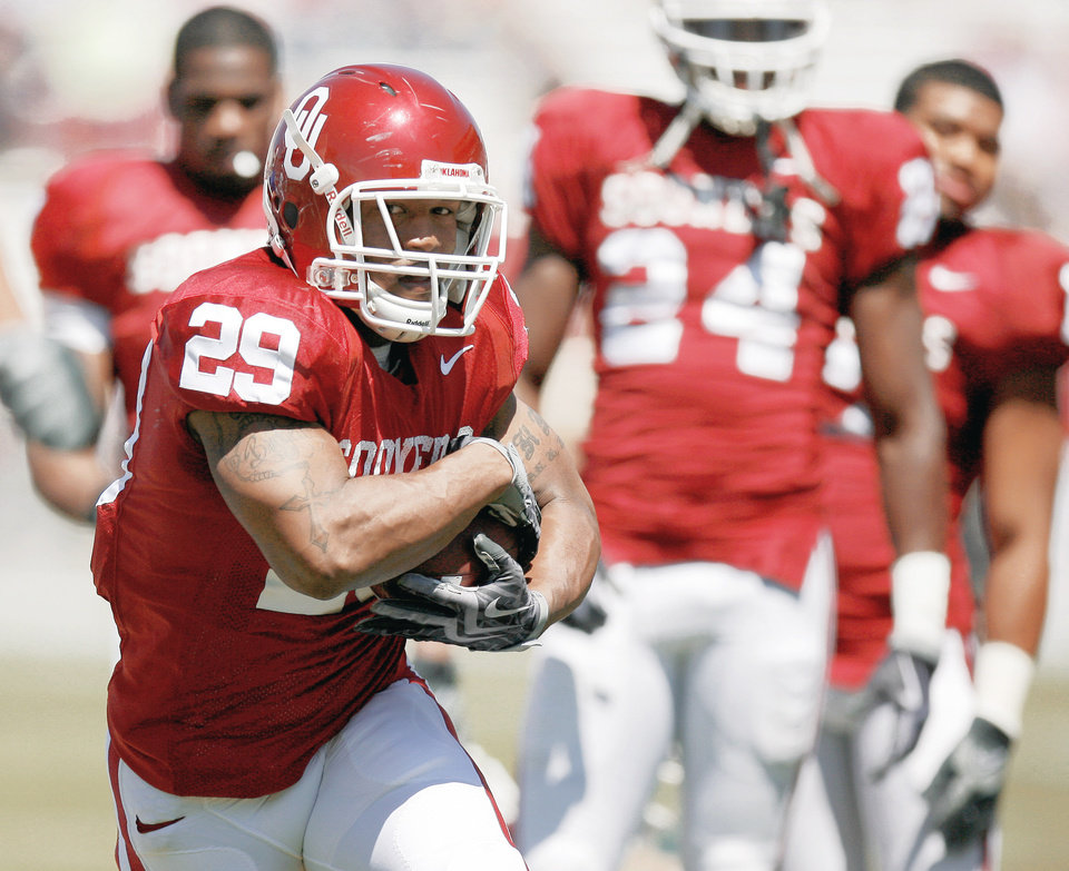 Photo - Last season, Oklahoma running backs Chris Brown, left, and DeMarco Murray became the first tandem in Big 12 history to rush for more than 1,000 yards each in a season. Photos by Bryan Terry and Nate Billings, The Oklahoman