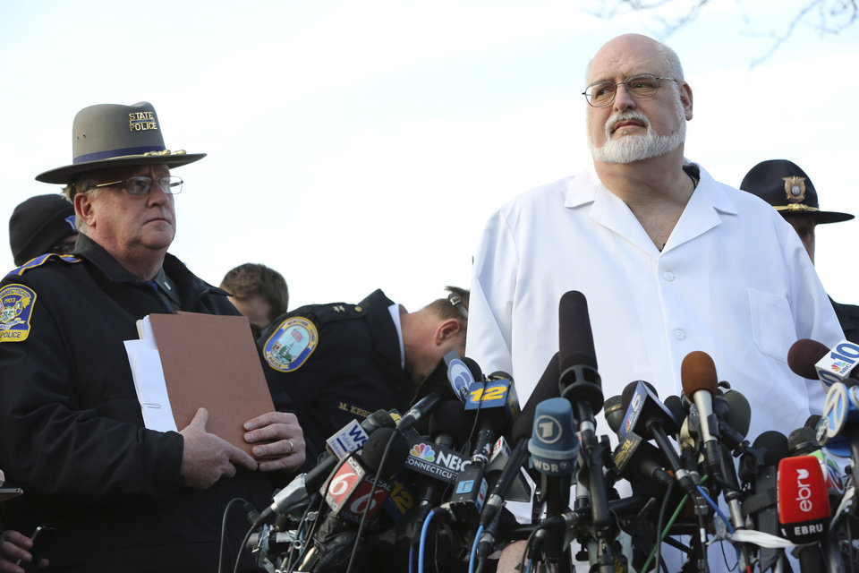 "Lt. J. Paul Vance, left, of the Connecticut State Police listens as Connecticut Chief Medical Examiner  H. Wayne Carver II, M.D. speaks to reporters during a news conference, Saturday, Dec. 15, 2012 in Sandy Hook village of Newtown, Conn.  The victims of the shooting were shot multiple times by semiautomatic rifle, the medical examiner said Saturday, and he called the injuries ""devastating"" and the worst he and colleagues had ever seen. Police began releasing the identities of the dead. All of the 20 children killed were 6 or 7 years old. Carver, said he examined seven of the children killed, and two had been shot at close range. When asked how many bullets were fired, he said, ""I'm lucky if I can tell you how many I found."" (AP Photo/Mary Altaffer)"