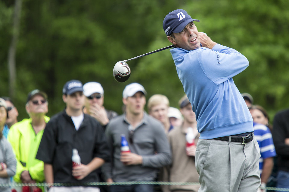 Photo - Matt Kuchar tees off on the 11th hole during the third round of the Houston Open golf tournament on Saturday, April 5, 2014, in Humble, Texas. (AP Photo/The Courier, Andrew Buckley)