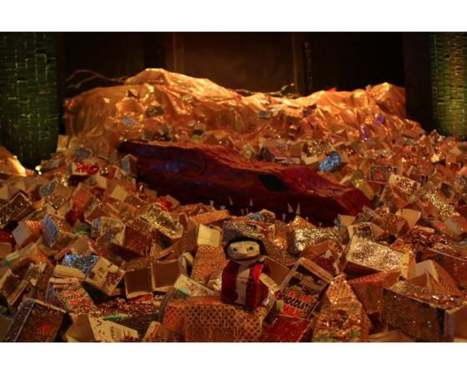"Photo -  Mustang Elementary School students won $1,500 for the school in the Evergreen Packaging spring contest. The students' design made from milk cartons is a Smaug, one of the primary characters in J.R.R. Tolkien's ""The Hobbit."" PHOTO PROVIDED      -"