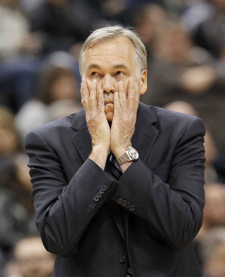 Photo - Los Angeles Lakers head coach Mike D'Antoni disagrees with a call during the first quarter of an NBA basketball game against the Minnesota Timberwolves in Minneapolis, Friday, March 28, 2014. The Timberwolves won 143-107. (AP Photo/Ann Heisenfelt)