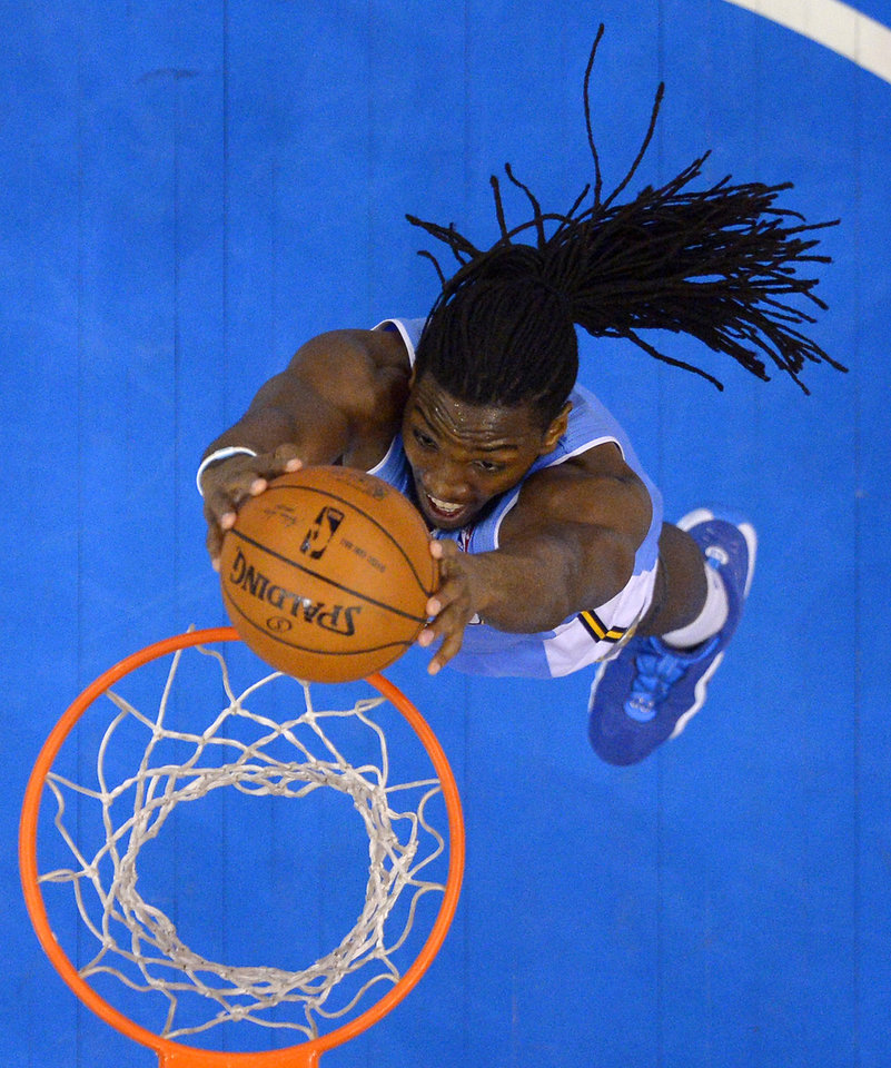 Photo - Denver Nuggets forward Kenneth Faried dunks during the second half of an NBA basketball game against the Los Angeles Clippers, Tuesday, April 15, 2014, in Los Angeles. The Clippers won the game 117-105. (AP Photo/Mark J. Terrill)