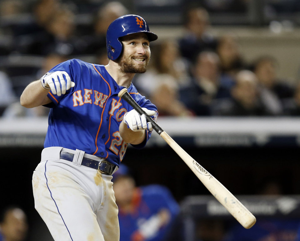 Photo - New York Mets Daniel Murphy watches the path of his fifth-inning, three-run, home run off New York Yankees relief pitcher Alfredo Aceves in a baseball game at Yankee Stadium in New York, Tuesday, May 13, 2014. (AP Photo)
