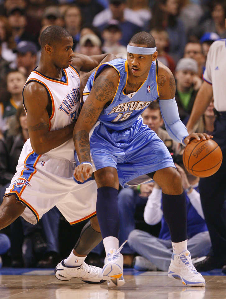 Desmond Mason guards Carmelo Anthony in the first half as the Oklahoma City Thunder play the Denver Nuggets at the Ford Center in Oklahoma City, Okla. on Friday, January 2, 2009.  Photo by Steve Sisney/The Oklahoman