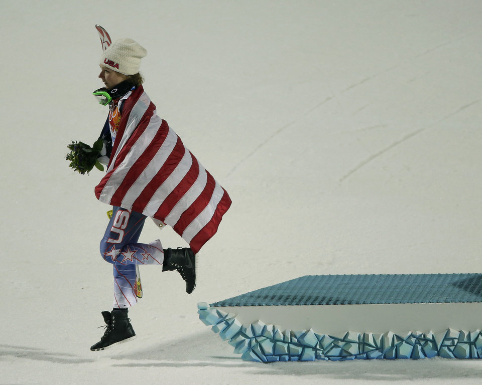 Photo - Women's gold medalist, United States' Mikaela Shiffrin, leaves the podium after the flower ceremony for the women's slalom at the Sochi 2014 Winter Olympics, Friday, Feb. 21, 2014, in Krasnaya Polyana, Russia. (AP Photo/Charlie Riedel)