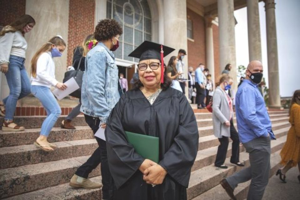Photo -  JoAnn Bowler, 81, poses for a photo after the 2020 winter commencement ceremony at Oklahoma Baptist University in Shawnee. [Kenny Day/OBU]