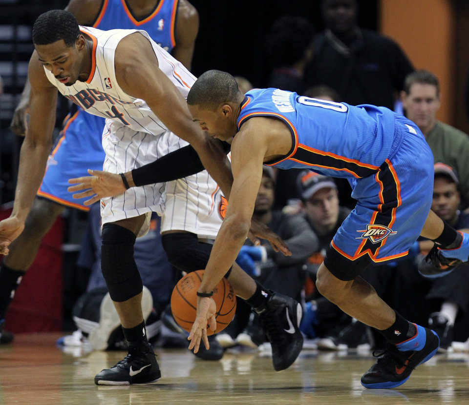 Photo - Charlotte forward Derrick Brown, left, battles for a loose ball with Thunder guard Russell Westbrook during Tuesday's game. AP PHOTO