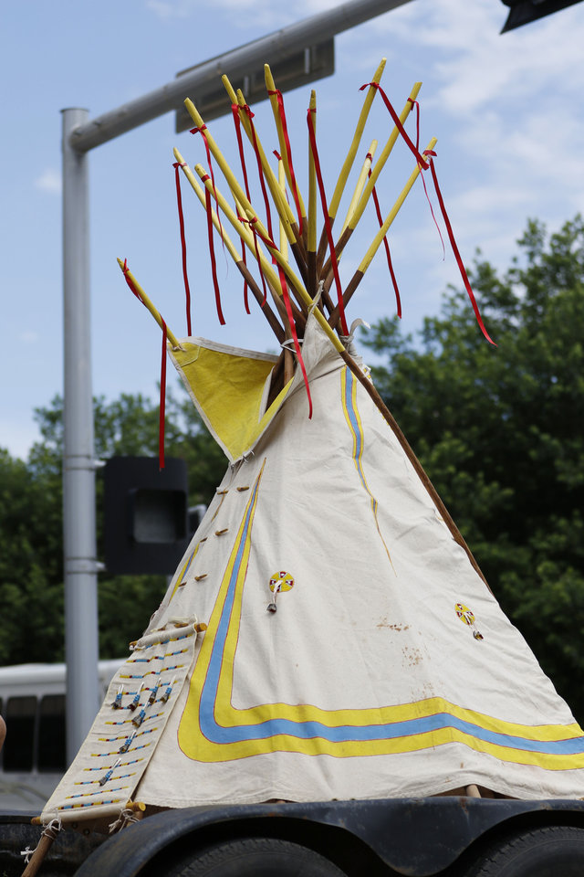 Photo - A teepee is set up on a trailer during the parade for the 2019 Red Earth Festival in downtown Oklahoma City, Oklahoma Saturday, June 8, 2019.  [Paxson Haws/The Oklahoman]