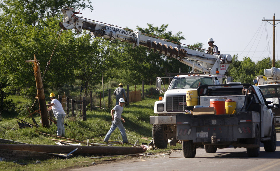 Photo - Crews replace utility lines outside a neighborhood in Woodward, Okla., Sunday, April 15, 2012. A tornado that killed five people struck Woodward, Okla., shortly after midnight on Sunday, April 15, 2012.  Photo by Bryan Terry, The Oklahoman