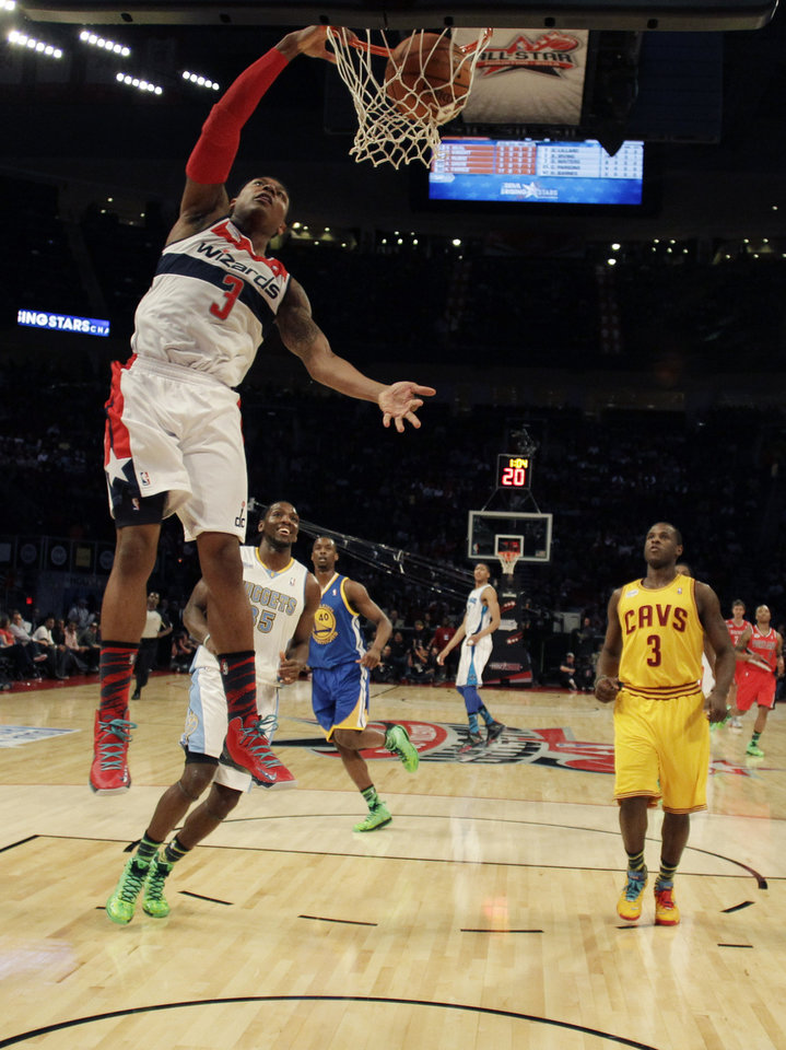 Team Chuck's Bradley Beal (3), of the Washington Wizards, dunks against Team Shaq during the first half of the Rising Stars Challenge basketball game at NBA All-Star Weekend, Friday, Feb. 15, 2013, in Houston. (AP Photo/Eric Gay)