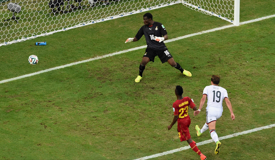 Photo - Germany's Mario Goetze, right, scores the opening goal during the group G World Cup soccer match between Germany and Ghana at the Arena Castelao in Fortaleza, Brazil, Saturday, June 21, 2014. (AP Photo/Francois Xavier Marit, pool)
