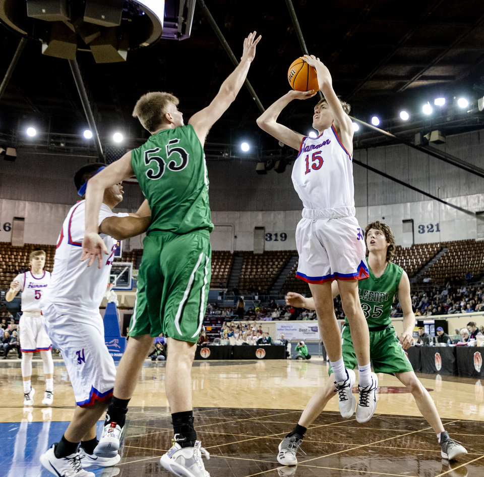 Photo - Hammon's Michael Land (15) puts up a shot over Leedey's Nathan Hill (55) during a Class B boys state tournament semi-final basketball game between Hammon vs Leedey in the Jim Norick Arena at State Fair Park in Oklahoma City, Okla. on Friday, March 6, 2020.  [Chris Landsberger/The Oklahoman]