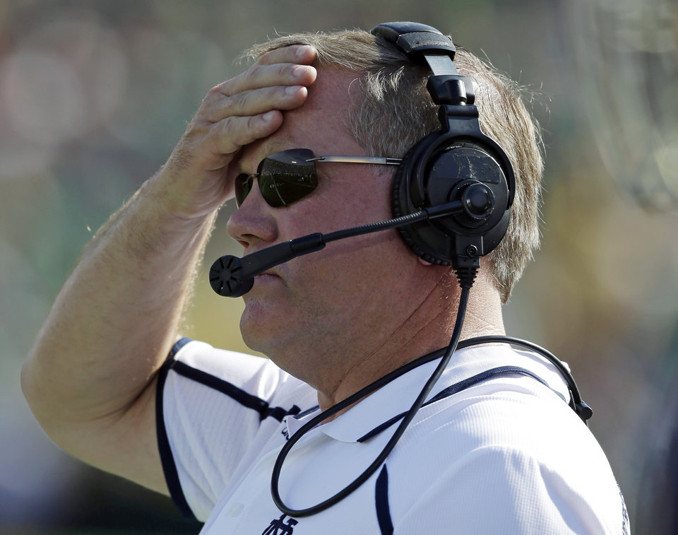 Notre Dame head coach Brian Kelly watches during the first half of an NCAA college football game against Oklahoma, Saturday, Sept. 28, 2013, in South Bend, Ind. (AP Photo/Darron Cummings)  ORG XMIT: INDC104