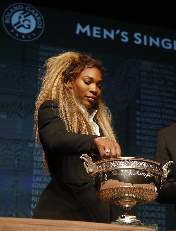 Photo - Defending champion Serena Williams, of the U.S, picks up a token during the Men's singles draw for the French Open Tennis tournament, at the Roland Garros stadium in Paris, Friday, May 23, 2014. The French Open tennis tournament starts Sunday. (AP Photo/Michel Euler)